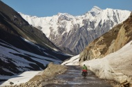Cycling from Kashmir to Ladakh over a beautiful snowy pass, India 2014.