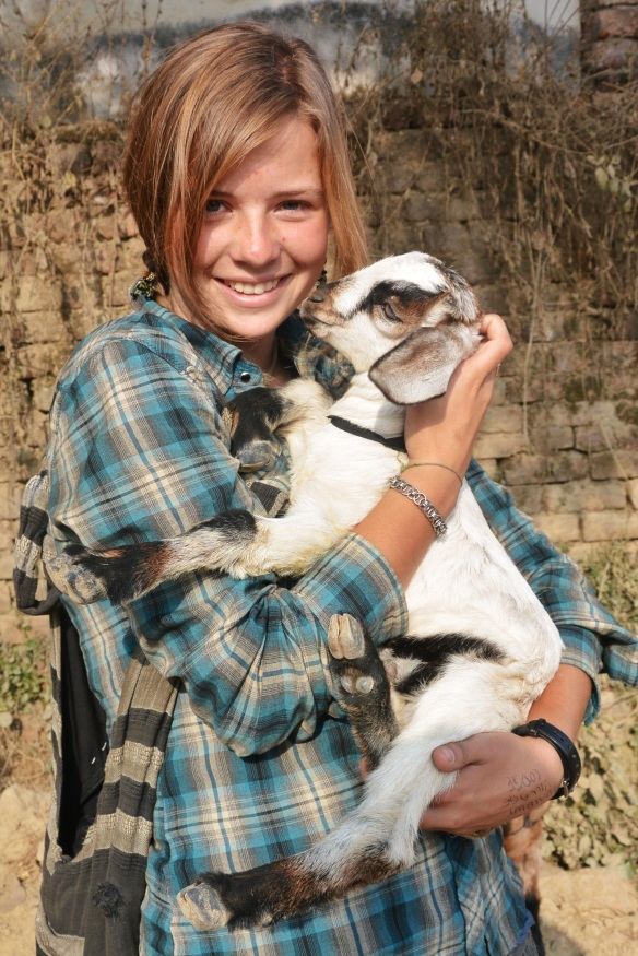 Me and one of the many goats I've tried to take with me!