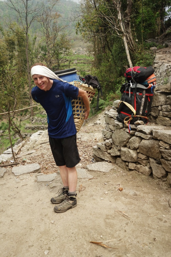 We encountered many porters during our trek as they would run up and down the mountain supplying different tea houses and many climbers, and a few Trekkers, relied upon these for food. Kevin tried their basket on, though it would take a lot of practice to hike with it!