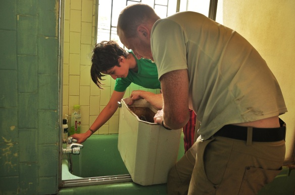 Kevin and our host trying to get the toilet flushing.
