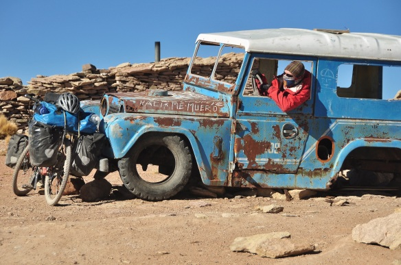 Kevin riding an old car he found at one of the abandoned mining villages.