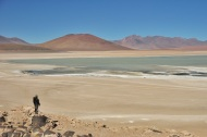 Admiring one of the funny colored lakes: colored due to the minerals.