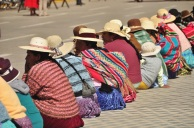 Typical Andean ladies: the hat, the cloth bag, the long braids, and the colorful pleated skirts. In everywhere except the largest cities, this is how the women always dress.