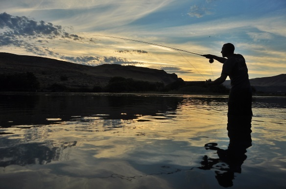 Kevin in his element: fly fishing as sunset.